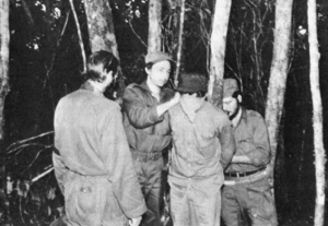 Raúl Castro blindfolding a rebel about to be executed by firing squad, for disobeying orders. CLICK TO ENLARGE.